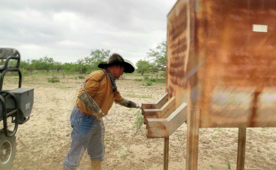 Charley Bowers, works on his land in Knickerbocker, Texas, 15 miles south of San Angelo.   Bowers, 56, is a cowboy, hunting guide, camp cook, a welder, a mechanic – a jack-of-all-rural trades, in other words – despite having lost both hands four years ago in a horrific electrical accident. Charley was in a bucket lift working on his mother-in-law's barn when a charge from a nearby power line coursed through his body. Most the photos were taken at the Adobe Lodge Hunting Camp, near Knickerbocker, owned by Charley's friend Skipper Duncan. Photo: Joe Holley, Houston Chronicle / Houston Chronicle