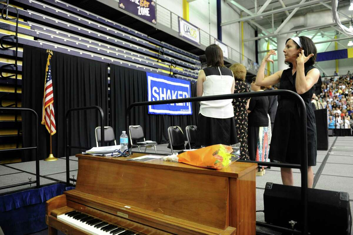 Sign language interpreter Liz Beauregard signs the national anthem during Shaker High Schools graduation commencement at the SEFCU Arena on Saturday June 22, 2013 in Albany, N.Y. (Michael P. Farrell/Times Union)