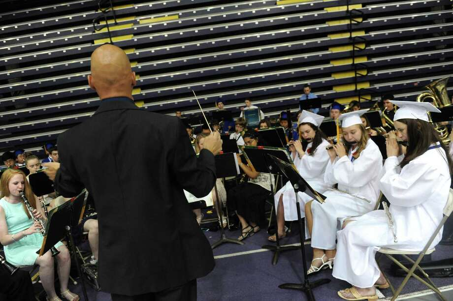 Music director Peter Suzuki conducts the Shaker High wind ensemble during Shaker High Schools graduation commencement at the SEFCU Arena on Saturday June 22, 2013 in Albany, N.Y. (Michael P. Farrell/Times Union) Photo: Michael P. Farrell