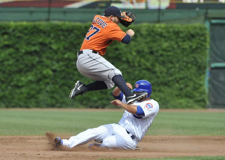 Welington Castillo of the Cubs is safe at second on a fielders choice as Jose Altuve of the Astros gets pulled off the bag.
