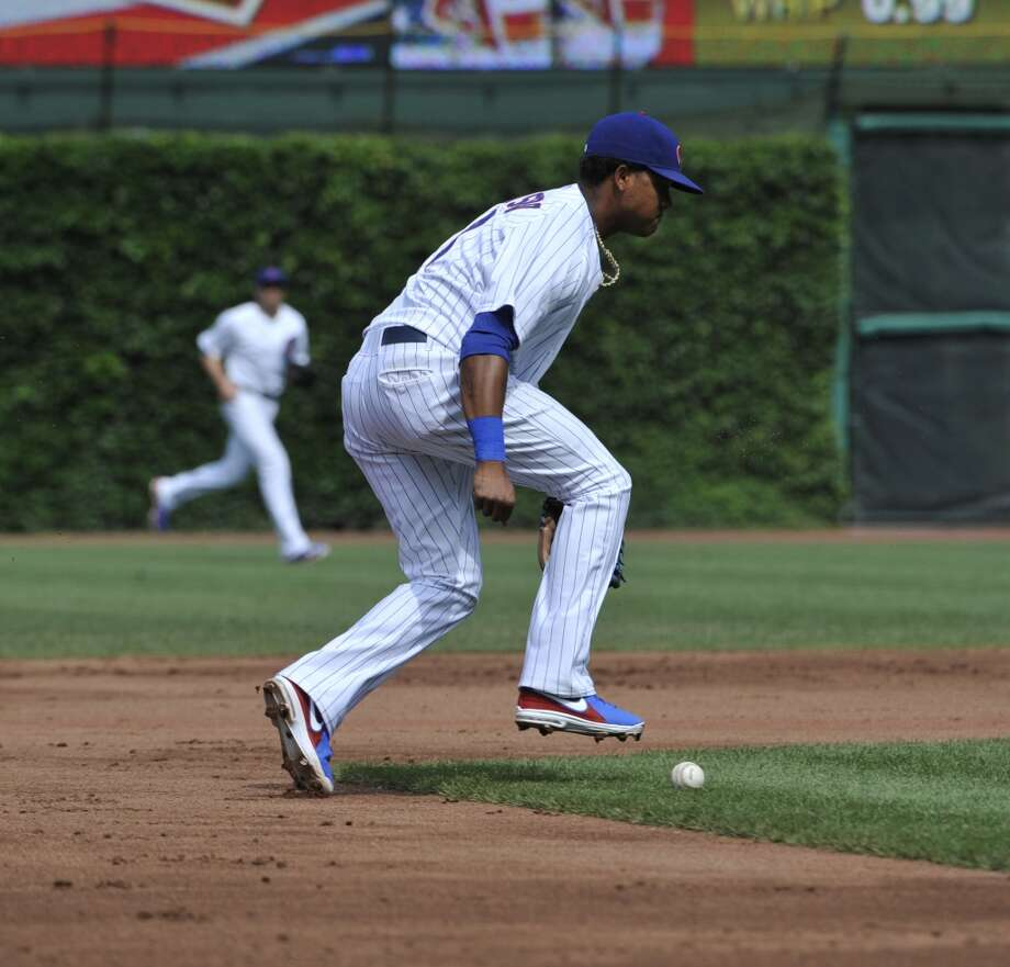 Starlin Castro of the Cubs makes an error.