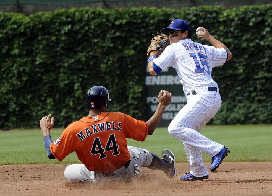 Justin Maxwell slides into second as Cubs second baseman Darwin Barney throws to first for a double play.
