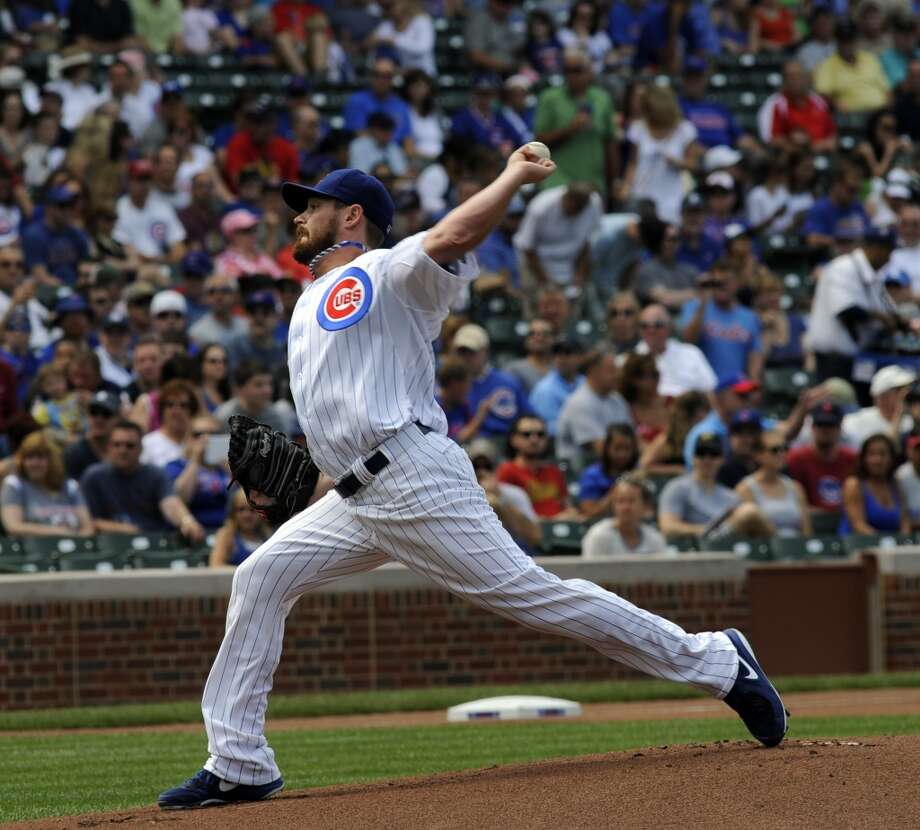 Cubs pitcher Travis Wood throws to a Astros batter.