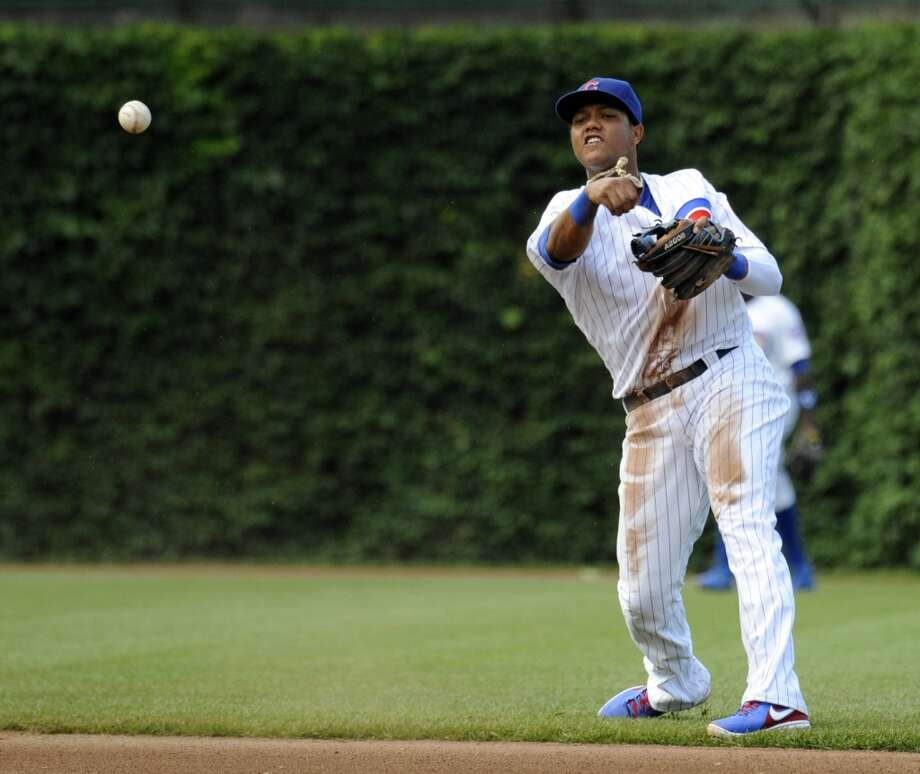Cubs shortstop Starlin Castro throws to first for an out.