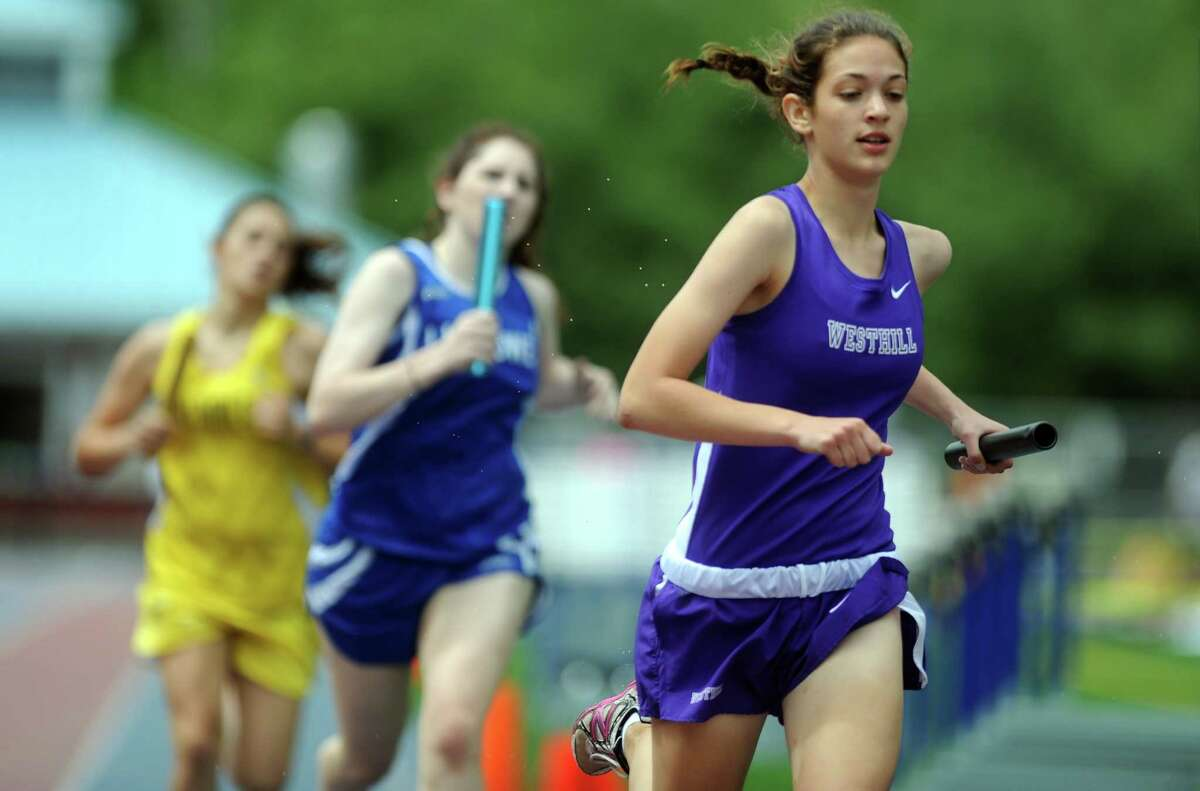Westhill's Claire Howlett competes in the 4x800 meter relay during the FCIAC boys and girls track championships held Tuesday, May 22, 2012 at Danbury High School. CORREX made on id