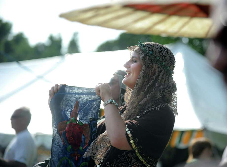 Xephyr Inkpen, of Pascoag, RI, cheers on her favorite performers during the Midsummer Fantasy Renaissance Faire Saturday, June 22, 2013 at Warsaw Park  in Ansonia, Conn. Photo: Autumn Driscoll / Connecticut Post