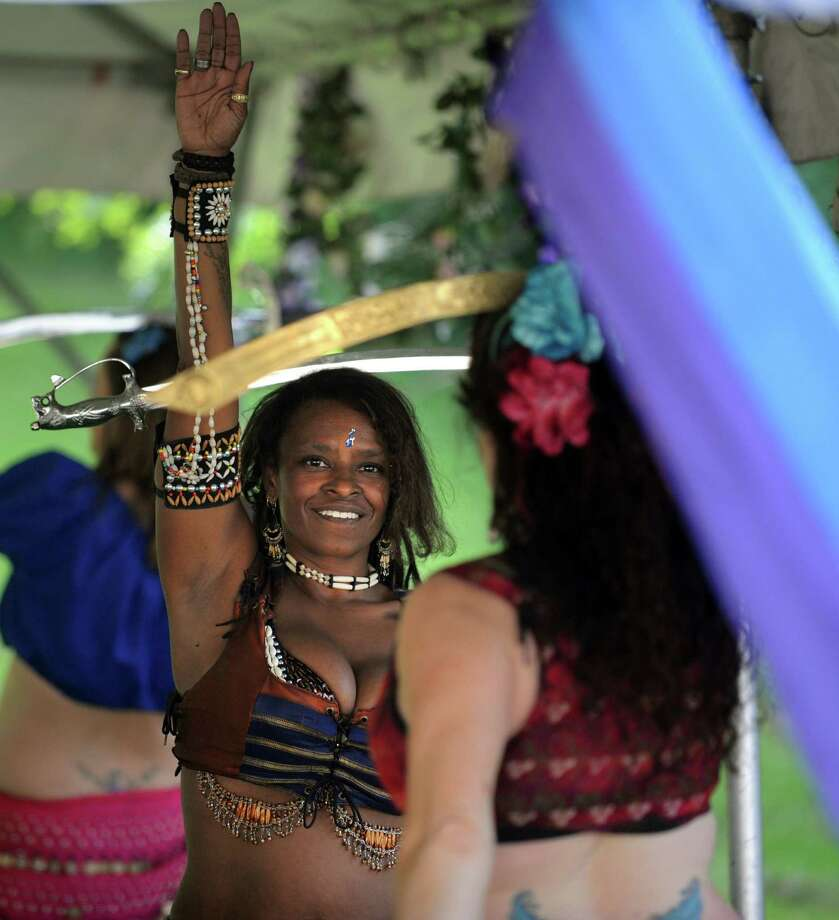 Courtnay Clarke, of Meriden, dances as Phoenix during the Midsummer Fantasy Renaissance Faire Saturday, June 22, 2013 at Warsaw Park  in Ansonia, Conn. Photo: Autumn Driscoll / Connecticut Post