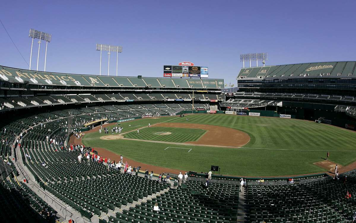 """FILE - This Sept. 30, 2007 file photo shows O.Co Coliseum, then called McAfee Coliseum, home of the Oakland Athletics baseball team, in Oakland, Calif. Major League Baseball is dragging its feet on having team owners vote on the Athletics' proposed move to a new ballpark 40 miles south in SanJose, SanJose city officials said in a lawsuit filed Tuesday, June 18, 2013. The lawsuit - filed in federal court in SanJose - is disputing MLB's exemption to federal antitrust law, which MLB has used as a """"guise"""" to control the location of teams, according to the suit. (AP Photo/Eric Risberg, File)"""
