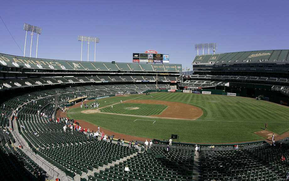 """FILE - This Sept. 30, 2007 file photo shows O.Co Coliseum, then called McAfee Coliseum, home of the Oakland Athletics baseball team, in Oakland, Calif. Major League Baseball is dragging its feet on having team owners vote on the Athletics' proposed move to a new ballpark 40 miles south in SanJose, SanJose city officials said in a lawsuit filed Tuesday, June 18, 2013. The lawsuit — filed in federal court in SanJose — is disputing MLB's exemption to federal antitrust law, which MLB has used as a """"guise"""" to control the location of teams, according to the suit. (AP Photo/Eric Risberg, File) Photo: Eric Risberg, Associated Press"""