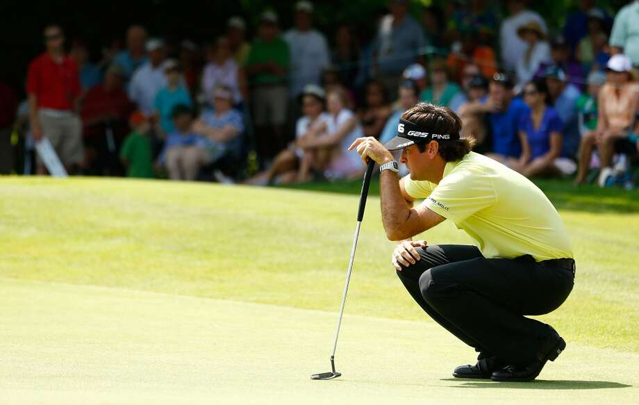 CROMWELL, CT- JUNE 22: Bubba Watson lines up his putt on the 5th green during the third round of the 2013 Travelers Championship at TPC River Highlands on June 22, 2012 in Cromwell, Connecticut.  (Photo by Jared Wickerham/Getty Images)