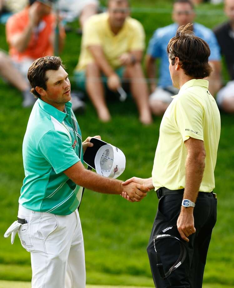 CROMWELL, CT- JUNE 22: Patrick Reed (L) and Bubba Watson (R) shake hands on the 18th hole during the third round of the 2013 Travelers Championship at TPC River Highlands on June 22, 2012 in Cromwell, Connecticut.  (Photo by Jared Wickerham/Getty Images)