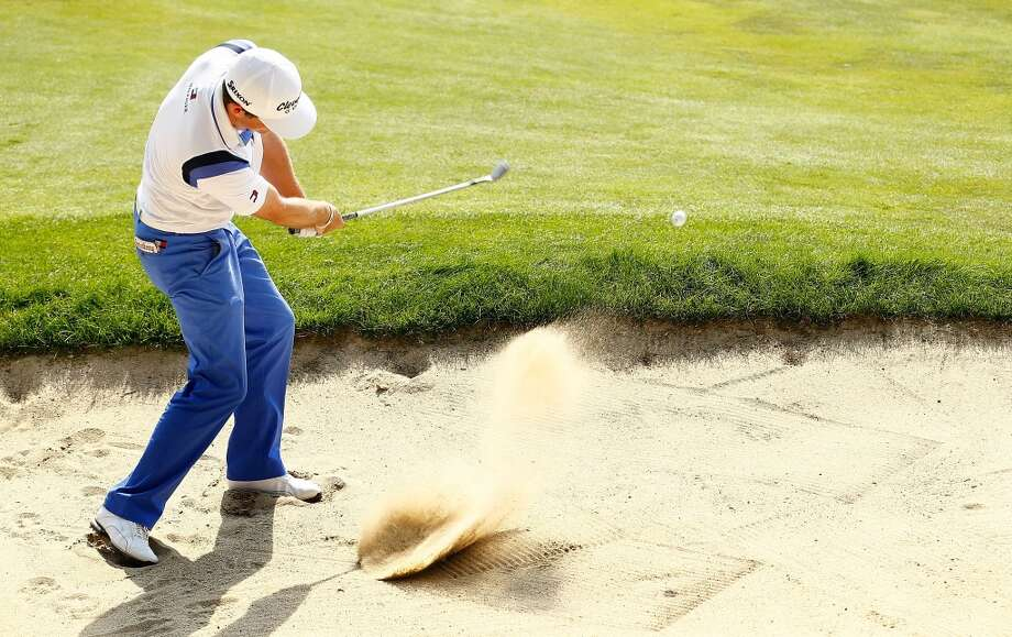 CROMWELL, CT- JUNE 22: Keegan Bradley hits his second shot out of the sand on the 15th hole during the third round of the 2013 Travelers Championship at TPC River Highlands on June 22, 2012 in Cromwell, Connecticut.  (Photo by Jared Wickerham/Getty Images)