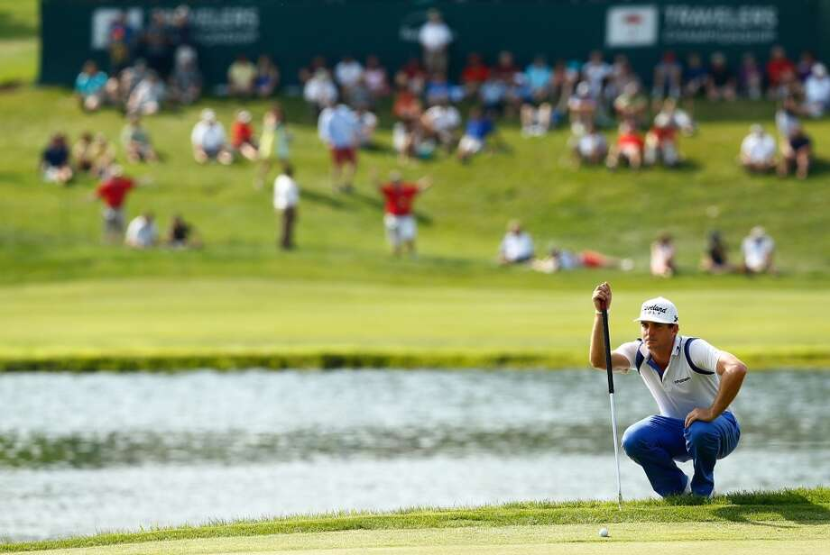 CROMWELL, CT- JUNE 22: Keegan Bradley lines up his putt on the 15th hole during the third round of the 2013 Travelers Championship at TPC River Highlands on June 22, 2012 in Cromwell, Connecticut.  (Photo by Jared Wickerham/Getty Images)
