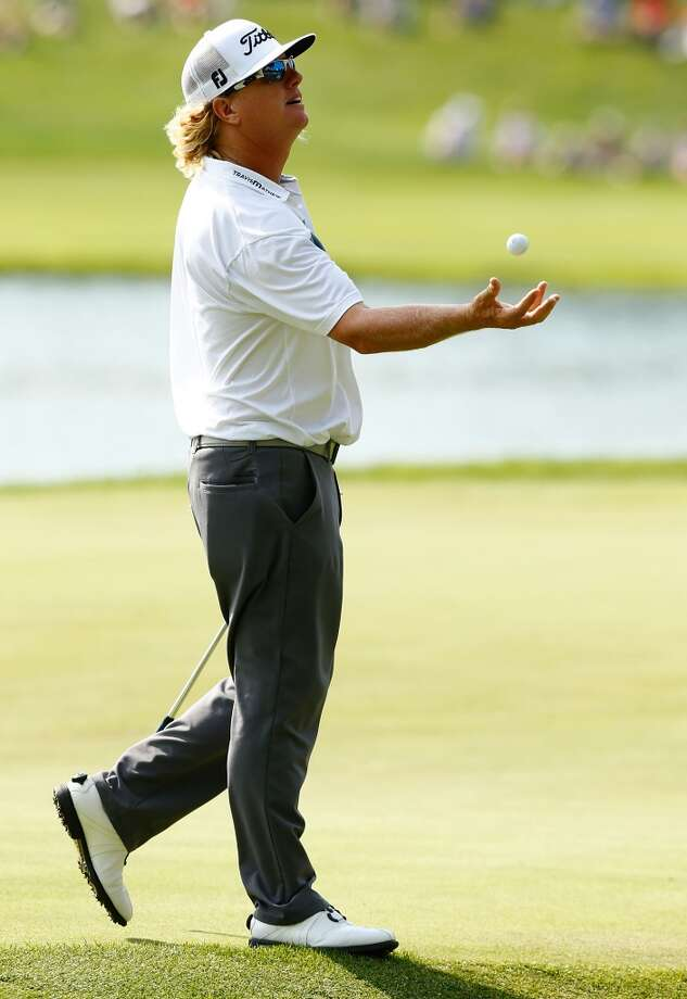 CROMWELL, CT- JUNE 22: Charley Hoffman throws a golf ball up in the air on the 15th hole during the third round of the 2013 Travelers Championship at TPC River Highlands on June 22, 2012 in Cromwell, Connecticut.  (Photo by Jared Wickerham/Getty Images)