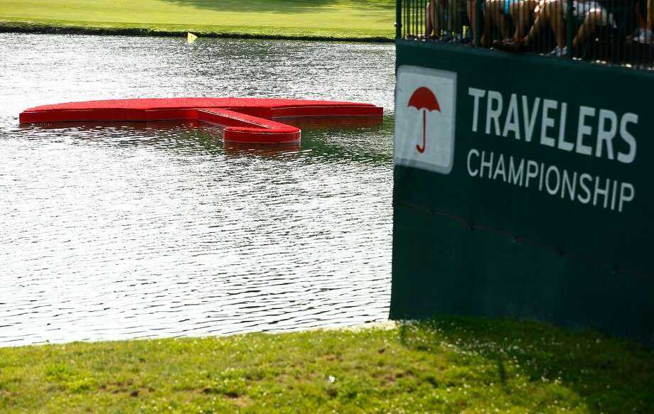 CROMWELL, CT- JUNE 22: A floating umbrella is shown near the 17th hole during the third round of the 2013 Travelers Championship at TPC River Highlands on June 22, 2012 in Cromwell, Connecticut.  (Photo by Jared Wickerham/Getty Images)