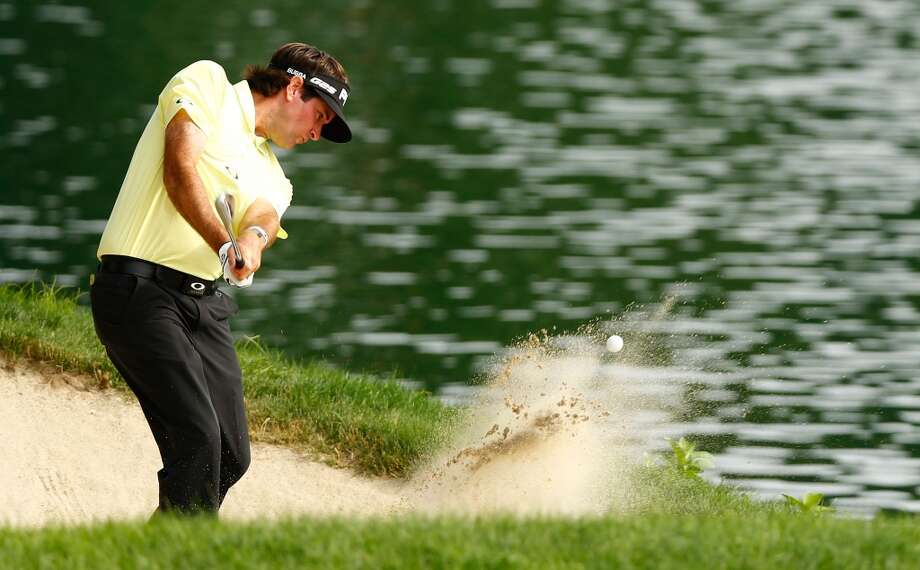 CROMWELL, CT- JUNE 22: Bubba Watson hits out of the sand on the 17th hole during the third round of the 2013 Travelers Championship at TPC River Highlands on June 22, 2012 in Cromwell, Connecticut.  (Photo by Jared Wickerham/Getty Images)