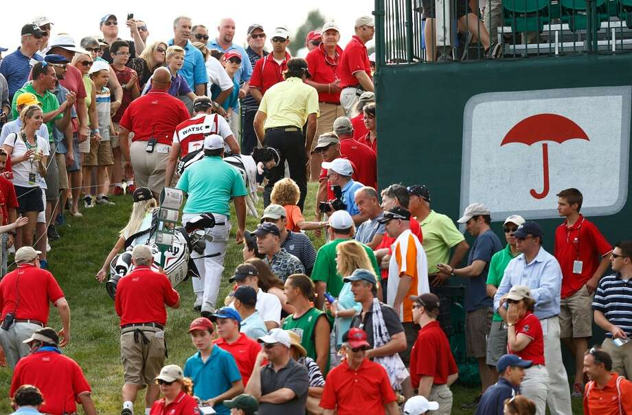 CROMWELL, CT- JUNE 22: Bubba Watson and Patrick Reed walk up the hill through the fans after finishing the 18th hole during the third round of the 2013 Travelers Championship at TPC River Highlands on June 22, 2012 in Cromwell, Connecticut.  (Photo by Jared Wickerham/Getty Images)