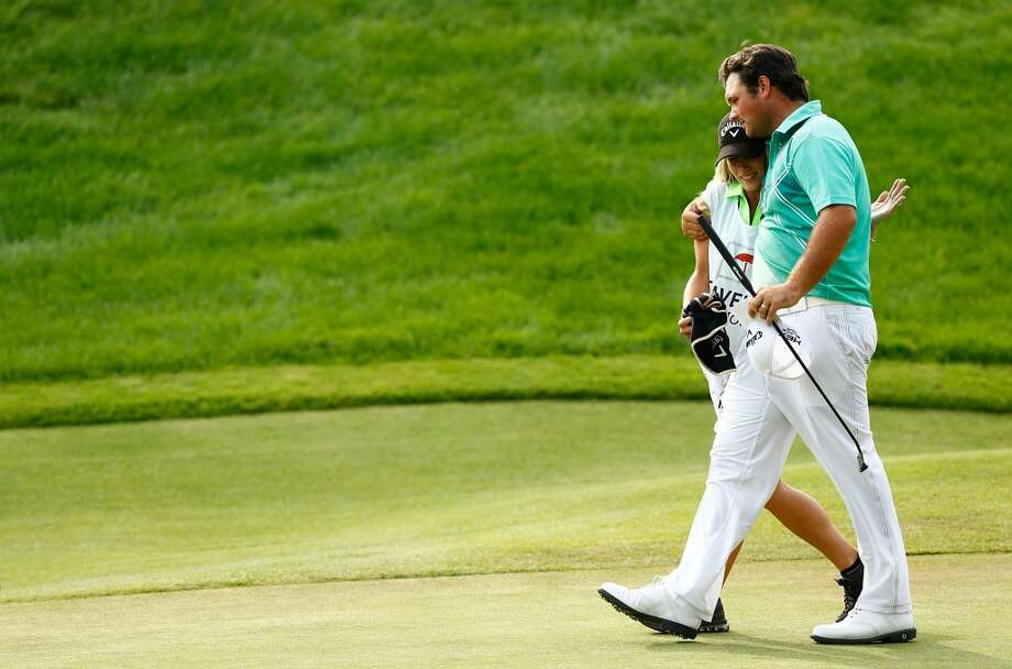 CROMWELL, CT- JUNE 22: Patrick Reed hugs his wife Justine Reed after finishing the 18th hole during the third round of the 2013 Travelers Championship at TPC River Highlands on June 22, 2012 in Cromwell, Connecticut.  (Photo by Jared Wickerham/Getty Images)