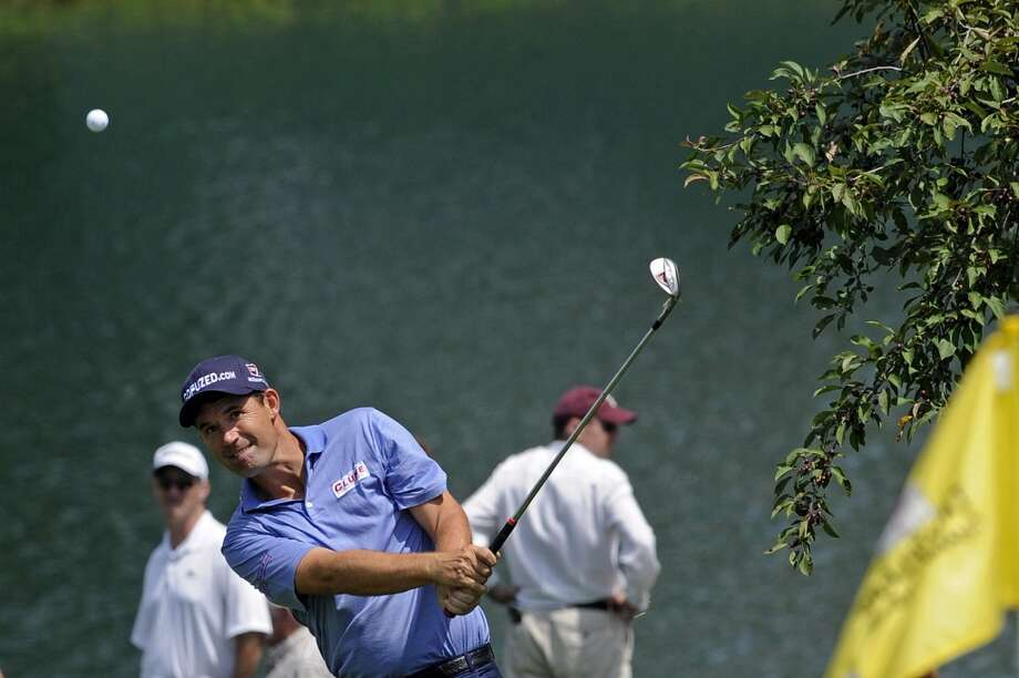Padraig Harrington, of Ireland, watches his chip shot on the first hole during the third round of the Travelers Championship golf tournament in Cromwell, Conn., Saturday, June 22, 2013. (AP Photo/Fred Beckham)