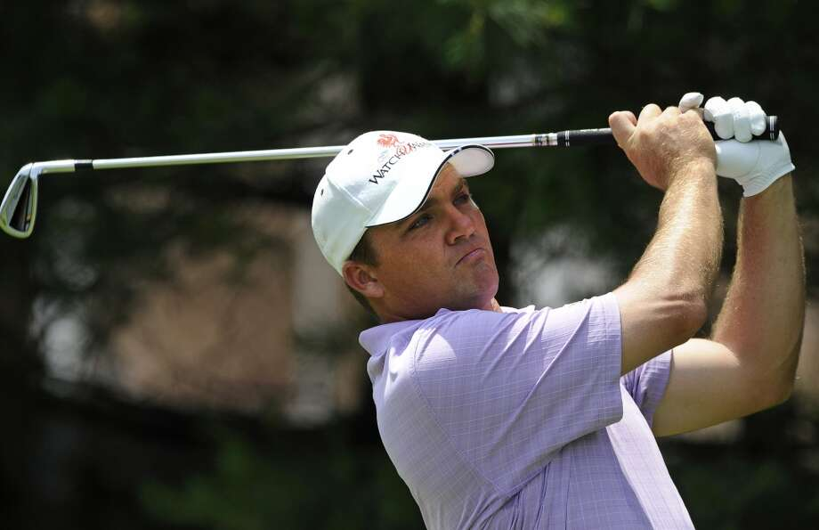 Nicholas Thompson watches his tee shot on the eighth hole during the third round of the Travelers Championship golf tournament in Cromwell, Conn., Saturday, June 22, 2013. (AP Photo/Fred Beckham)