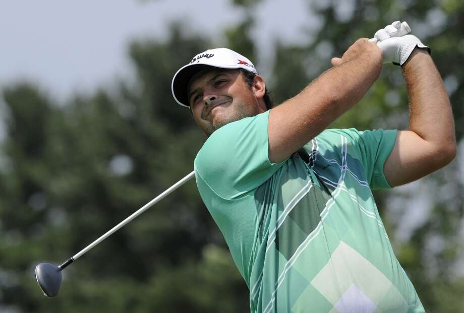 Patrick Reed watches his drive on the second hole during the third round of the Travelers Championship golf tournament in Cromwell, Conn., Saturday, June 22, 2013. (AP Photo/Fred Beckham)