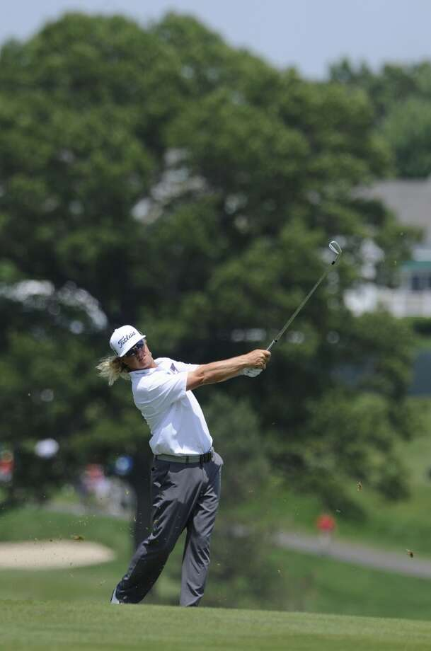 Charley Hoffman hits an approach shot on the second hole during the third round of the Travelers Championship golf tournament in Cromwell, Conn., Saturday, June 22, 2013. (AP Photo/Fred Beckham)
