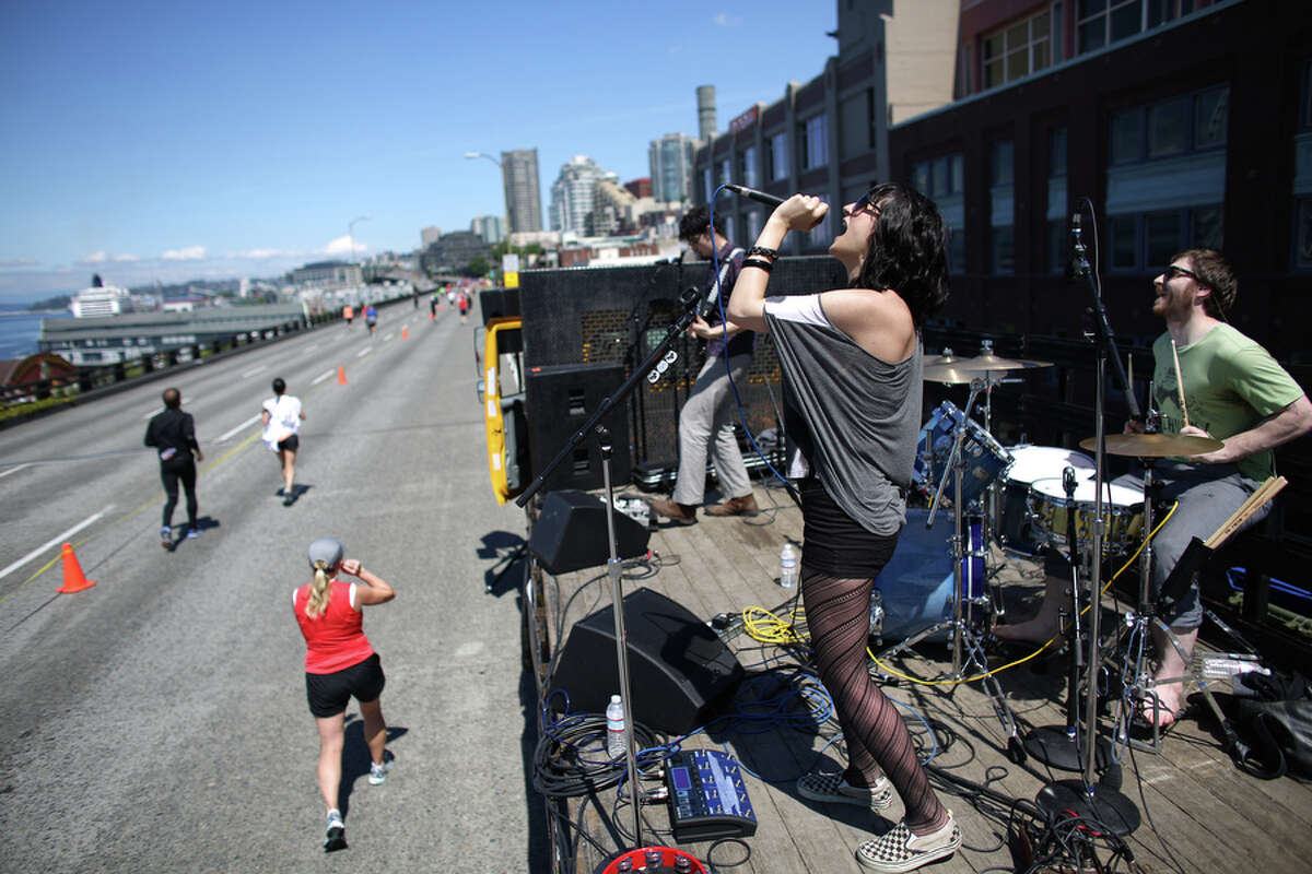 Amber Shine performs with her band Yevtushenko on the Alaskan Way Viaduct during the annual Rock 'n' Roll Seattle Marathon on Saturday, June 22, 2013. More than 20,000 participants started the 26.2 mile marathon course and 13.1 1/2 marathon course.
