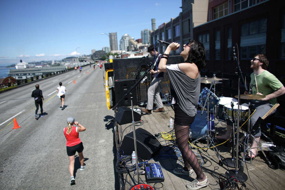 Amber Shine performs with her band Yevtushenko on the Alaskan Way Viaduct  during the annual Rock 'n' Roll Seattle Marathon on Saturday, June 22, 2013. More than 20,000 participants started the 26.2 mile marathon course and 13.1 1/2 marathon course. Photo: JOSHUA TRUJILLO, SEATTLEPI.COM / SEATTLEPI.COM