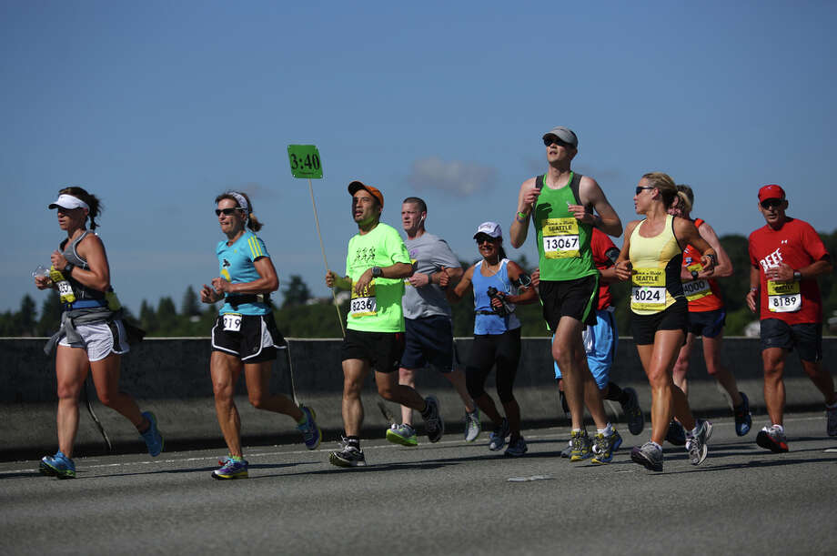 Runners make their way along Interstate 90. Photo: JOSHUA TRUJILLO, SEATTLEPI.COM / SEATTLEPI.COM