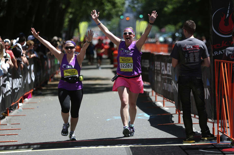 Runners cross the finish line. Photo: JOSHUA TRUJILLO, SEATTLEPI.COM / SEATTLEPI.COM