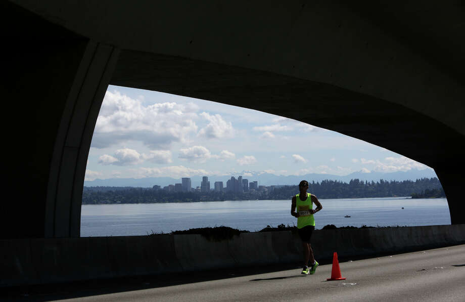 A runner crosses the Interstate 90 bridge. Photo: JOSHUA TRUJILLO, SEATTLEPI.COM / SEATTLEPI.COM