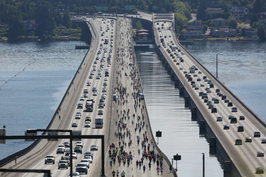Runners cross the Interstate 90 floating bridge during the annual Rock 'n' Roll Seattle Marathon. More than 20,000 participants started the 26.2 mile marathon course and 13.1 1/2 marathon course. Photo: JOSHUA TRUJILLO, SEATTLEPI.COM / SEATTLEPI.COM