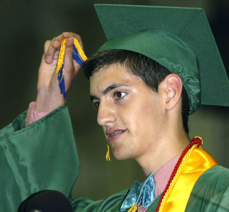 Class of 2013 president Ben Lawson leads his fellow graduates inthe traditional turning of the tassel to climax Saturday's New Milford High School graduation ceremony at the O'Neill Center on the campus of Western Connecticut State University in Danbury.  June 22, 2013 Photo: Norm Cummings
