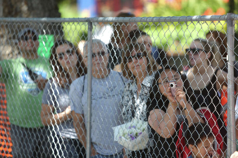Spectators watch the finish from behind a security fence. Photo: JOSHUA TRUJILLO, SEATTLEPI.COM / SEATTLEPI.COM