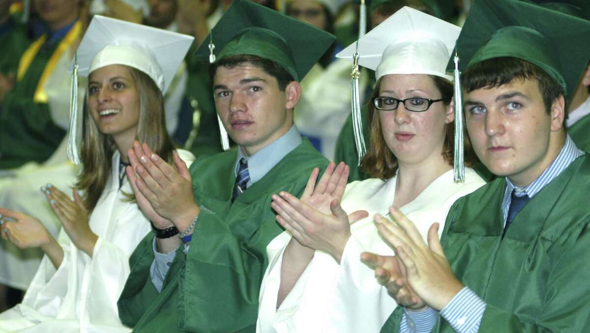 Applauding the salutatory address of fellow graduate Quentin Leitz are, from left, to right, Sofia Amaral, Louis Alhage, Hannah Albright and Trevor Agne during Saturday's New Milford High School graduation ceremony at the O'Neill Center on the campus of Western Connecticut State University in Danbury. June 22, 2013