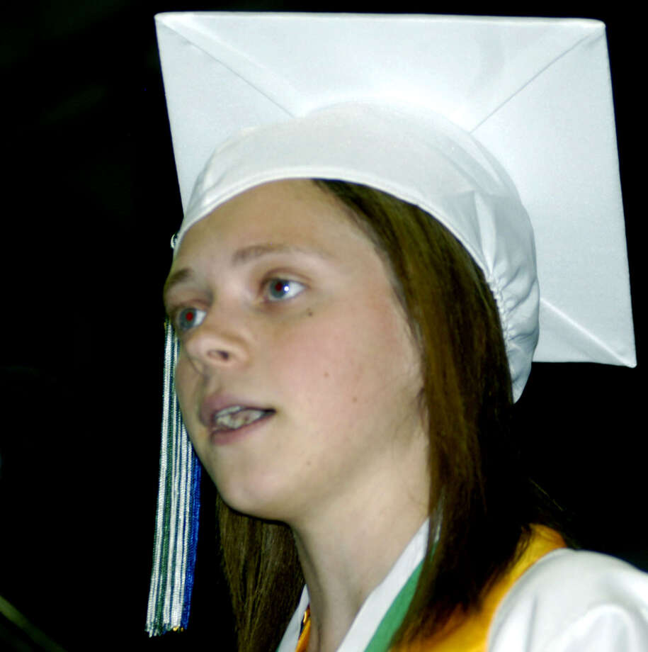 "Valedictorian Krista Pullen reminds her fellow grads ""this is just the beginning,"" during Saturday's New Milford High School graduation ceremony at the O'Neill Center on the campus of Western Connecticut State University in Danbury.  June 22, 2013 Photo: Norm Cummings"