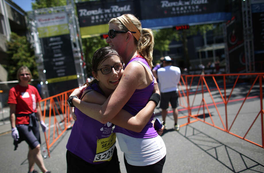 Carlota Fluxa embraces Erica Reading as they cross the finish line. Photo: JOSHUA TRUJILLO, SEATTLEPI.COM / SEATTLEPI.COM