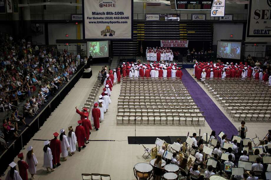 Graduating students file in to the SEFCU Arena for the Guilderland High School commencement ceremony held at the University at Albany on Saturday June 22, 2013 in Albany, N.Y. (Dan Little/Special to the Times Union) Photo: Dan Little / ©2013 Dan Little