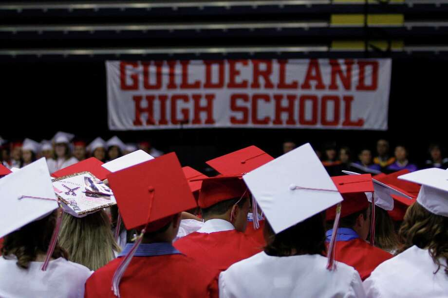 Guilderland High School graduating students attend their commencement ceremony held at the University at Albany SEFCU Arena on Saturday June 22, 2013 in Albany, N.Y. (Dan Little/Special to the Times Union) Photo: Dan Little / ©2013 Dan Little