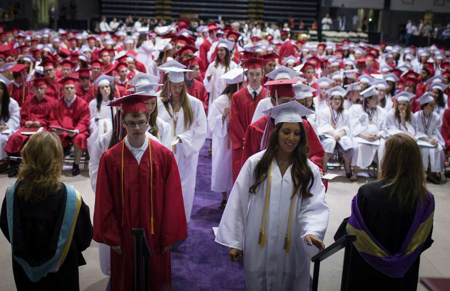 Guilderland High School graduating students line up double file to receive their deplomas during the commencement ceremony held at the University at Albany SEFCU Arena on Saturday June 22, 2013 in Albany, N.Y. (Dan Little/Special to the Times Union) Photo: Dan Little / ©2013 Dan Little