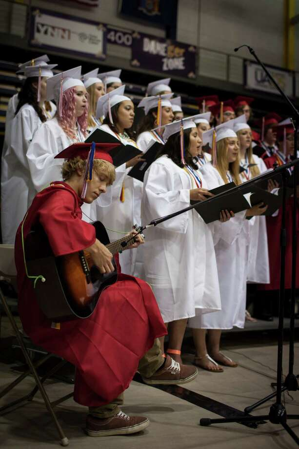 Riley Snyder plays guitar as the Guilderland High School concert choir seniors perform during the commencement ceremony held at the University at Albany SEFCU Arena on Saturday June 22, 2013 in Albany, N.Y. (Dan Little/Special to the Times Union) Photo: Dan Little / ©2013 Dan Little