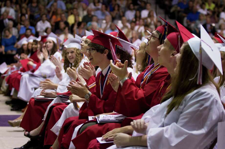 Guilderland High School graduating students applaud after receiving their deplomas during the commencement ceremony held at the University at Albany SEFCU Arena on Saturday June 22, 2013 in Albany, N.Y. (Dan Little/Special to the Times Union) Photo: Dan Little / ©2013 Dan Little