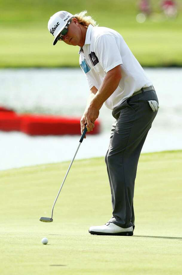 CROMWELL, CT- JUNE 22: Charley Hoffman putts on the 15th green during the third round of the 2013 Travelers Championship at TPC River Highlands on June 22, 2012 in Cromwell, Connecticut. Photo: Jared Wickerham, Getty Images / 2013 Getty Images