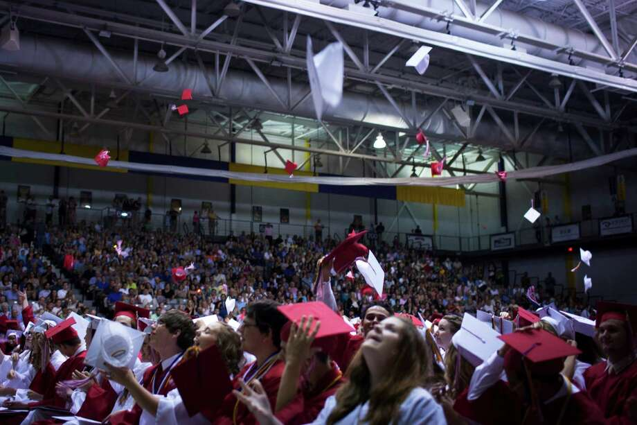 Guilderland High School graduating students toss their caps as an end comes to the commencement ceremony held at the University at Albany SEFCU Arena on Saturday June 22, 2013 in Albany, N.Y. (Dan Little/Special to the Times Union) Photo: Dan Little / ©2013 Dan Little