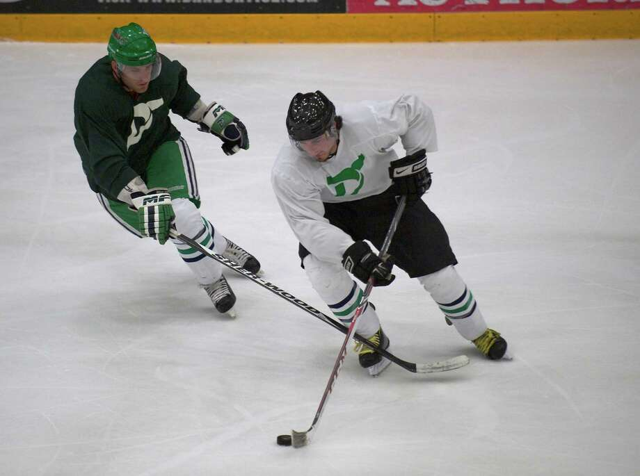 Bill Walsh, white jersey, and James Ryerse, green jersey, playing in the Danbury Whalers 4th annual Summer All-Star Game at the Danbury Arena, Danbury Conn on June 22 2013. Photo: H John Voorhees III
