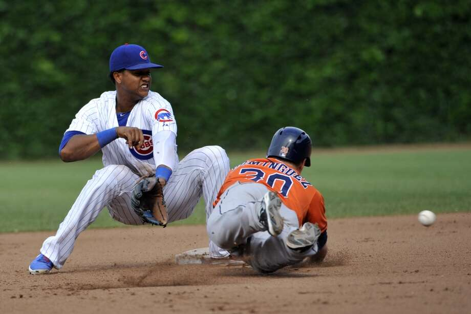 Matt Dominguez of the Astros dives back safely into second base on a pick-off attempt.