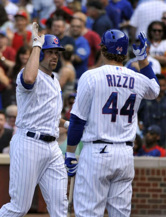 Nate Schierholtz is greeted by teammate Anthony Rizzo after hitting a home run.