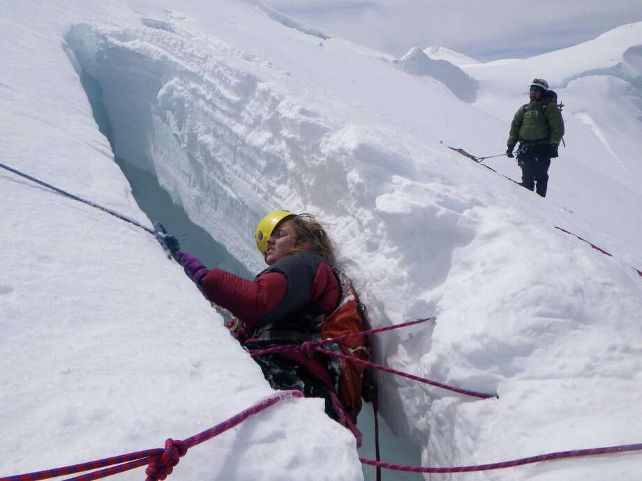 Noelle Smith as she is pulled out of a crevasse where she was  hanging by a rope after an accident involving four Texas climbers. (Photo by Stacey Wren) June 21, 2012
