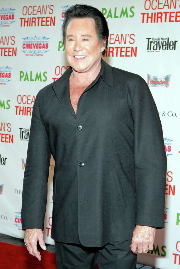 "FILE - This June 6, 2007 file photo shows singer Wayne Newton at the premiere of ""Ocean's Thirteen"" at the Palms Hotel-Casino in Las Vegas. A federal bankruptcy judge is poised to sign off Friday June 21, 2013, on a legal settlement will result in Newton moving from his sprawling ""Casa de Shenandoah"" property after 45 years. (AP Photo/Jae C. Hong, File) Photo: Jae C. Hong"