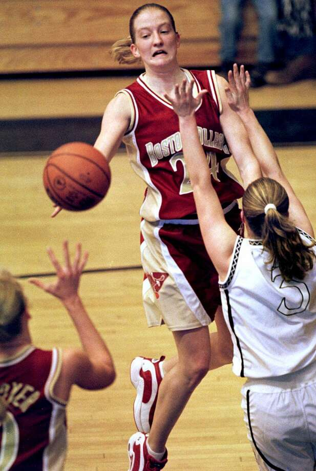 Boston College's Nicole Conway, center,  passes the ball by  Providence's defender Cnrissy Vozab, right, to teammate Jamie Cournoyer in first-half action in Providence, Saturday, Jan. 22,  2000. (AP Photo/ Jim Rogash) Photo: JIM ROGASH / AP